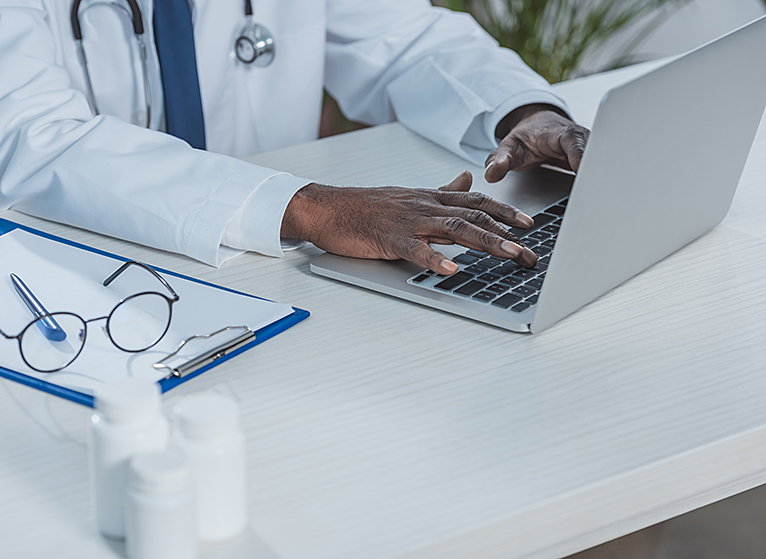 doctor working with laptop