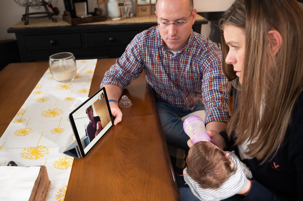 new parents use their ipad at home to meet with doctors at UVA.