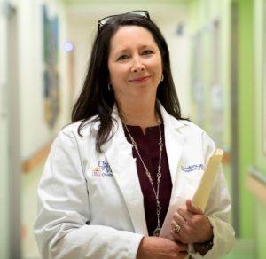 Headshot of Ann Kellams in the hallways of Pediatrics