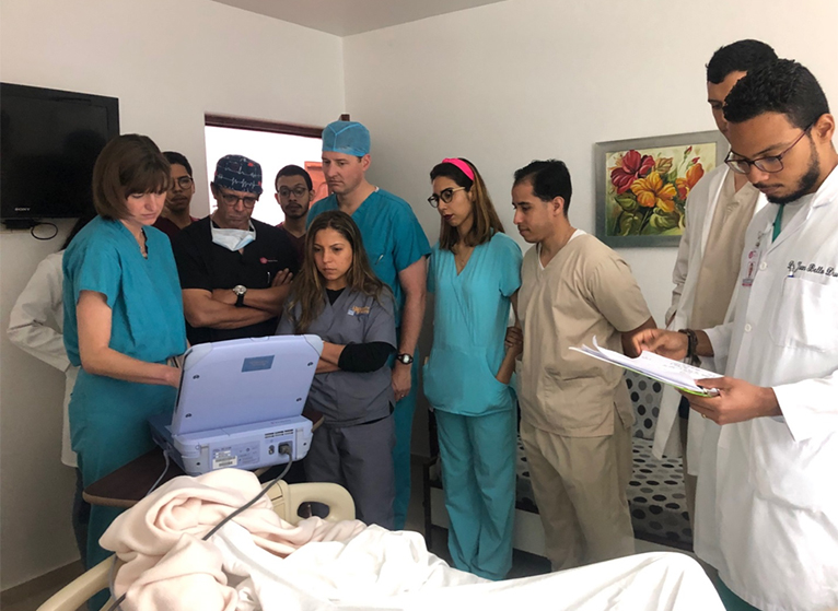 residents and doctors in patients room