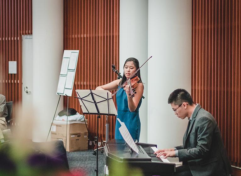 Photo: UVA Medical Student playing violin.
