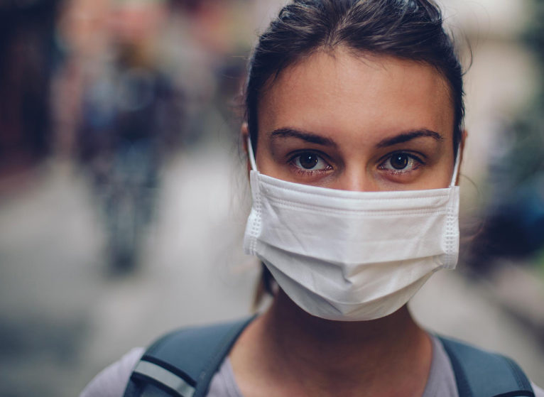 Woman wearing a mask to protect herself from Coronavirus