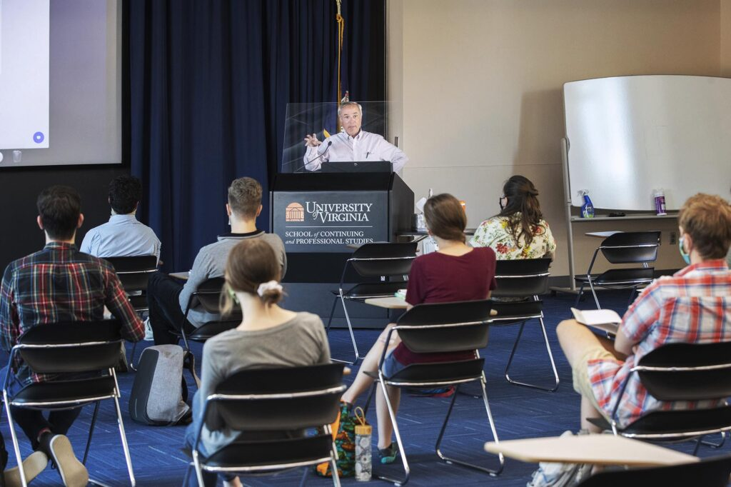 Cohort members attend a weekly seminar, taught by Dr. Robert Powers, on U.S. health care.
